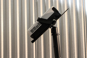 Tilting projector speaker stand mount